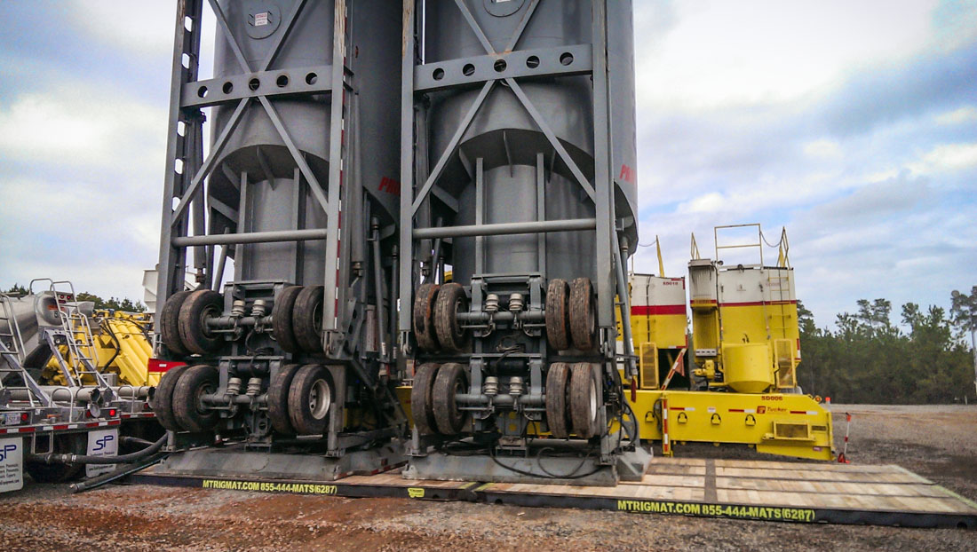 tanks on rig mats in north dakota oilfield bakken formation